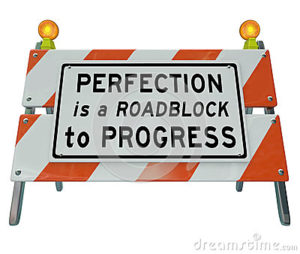 perfection-roadblock-to-progress-barrier-barricade-sign-words-road-construction-illustrate-drive-toward-39264941