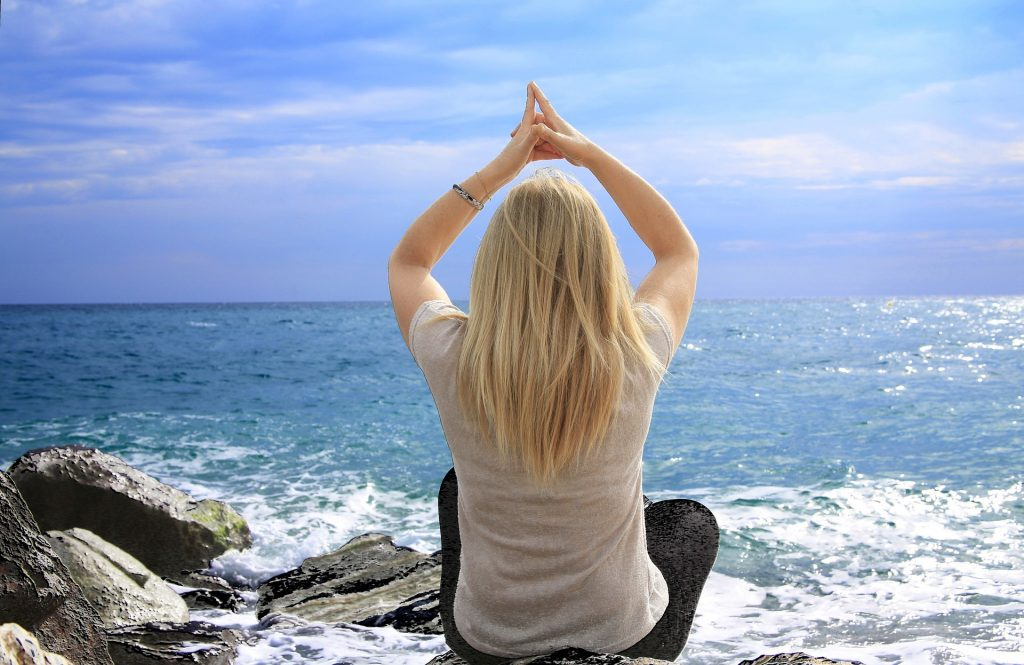 Woman meditation by the ocean